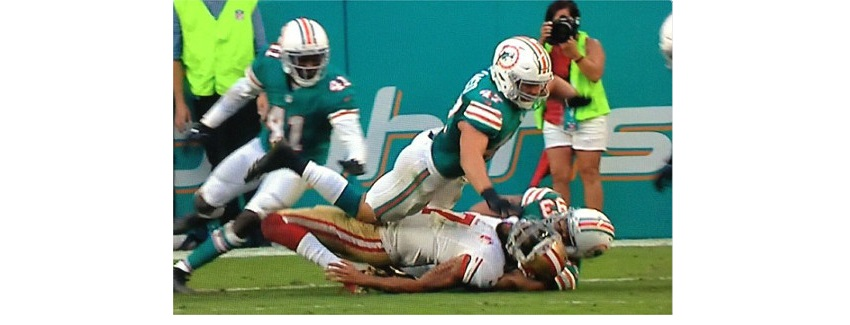 KaepernickTackled.jpg